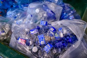 GM's Bradburn, Recyled Bottles, Chevrolet Equinox   General Motors is turning its employees' empty water bottles into a full new life: noise-reducing fabric insulation that covers the Chevrolet Equinox engine. The bottles – collected from four of its Michigan facilities – are also being turned into air filtration components and insulation for coats for the homeless community. (Photo by Santa Fabio for General Motors)